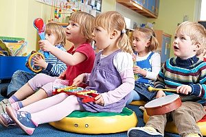 a Christian play-based preschool where children are learning music and playing instruments for the first time in their lives