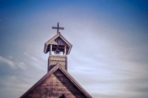 a picture of a cross on top of a church that has been able to answer the questions as to why go to church