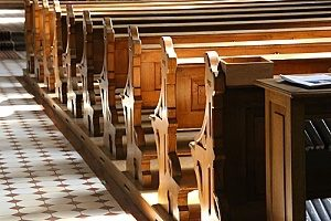 pews at a church that a person is visiting after having asked why go to church