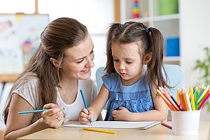 a young child and her mother practicing what school will be like so she can get the best possible Christian preschool education there is to offer