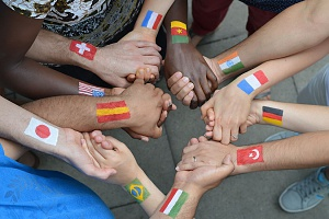 people from different countires holding hands and participating in interfaith cooperation