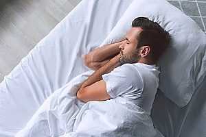 a man getting great sleep after he attended Sunday worship services for the first time in years