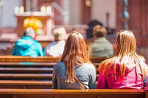 a mother and her daughter attending Lutheran church services